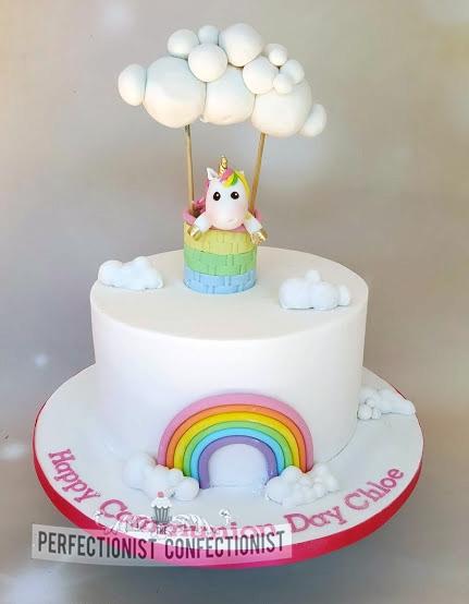 Chloe - Rainbow Unicorn Communion Cake